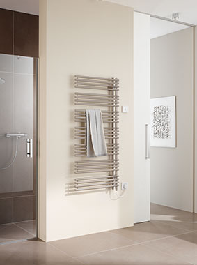 Kermi Diveo-E design and bathroom radiator for all-electric operation with WFS electrical set