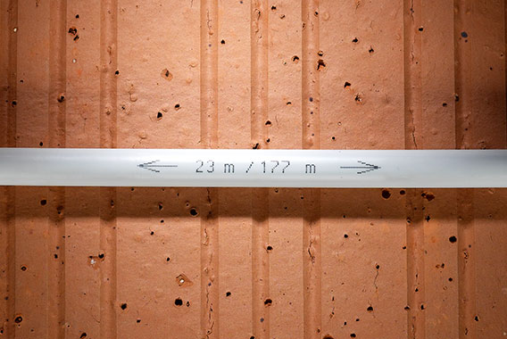 Kermi x-net C21: pipe inscription indicates remaining length and pipe length already used